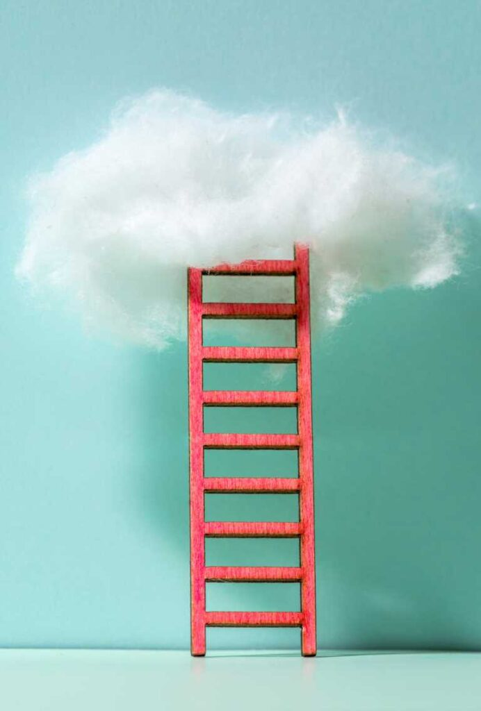 Red ladder to the clouds metaphor